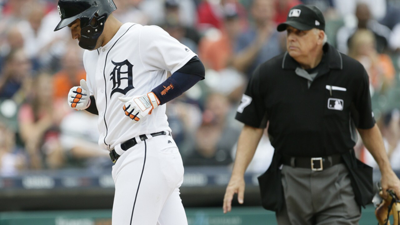 After Mike Fiers gets hurt, Jose Iglesias leads Tigers over Reds