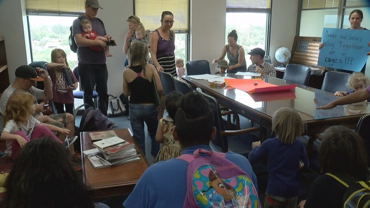 "Protestors stage ""play date"" at McSally's office"