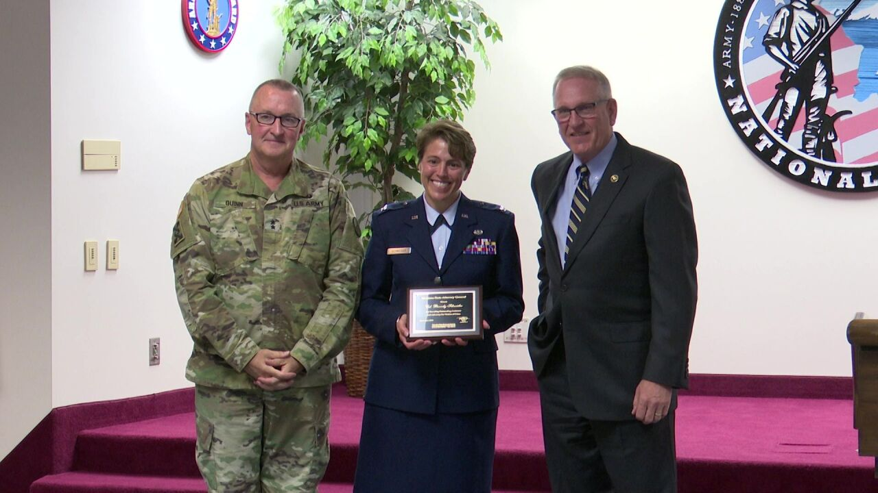 "MT AG Fox presented the ""Outstanding Advocate of the Year"" award to Colonel Beverly Schneider"