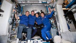 Four NASA astronauts pose for a portrait aboard the International Space Station. From left are Flight Engineers Nick Hague, Andrew Morgan, Christina Koch and Jessica Meir.