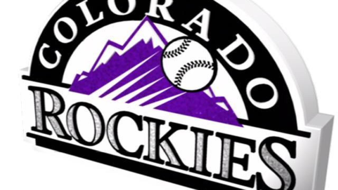 Gray crisp over 7, playoff-chasing Rockies rout Phils 10-1