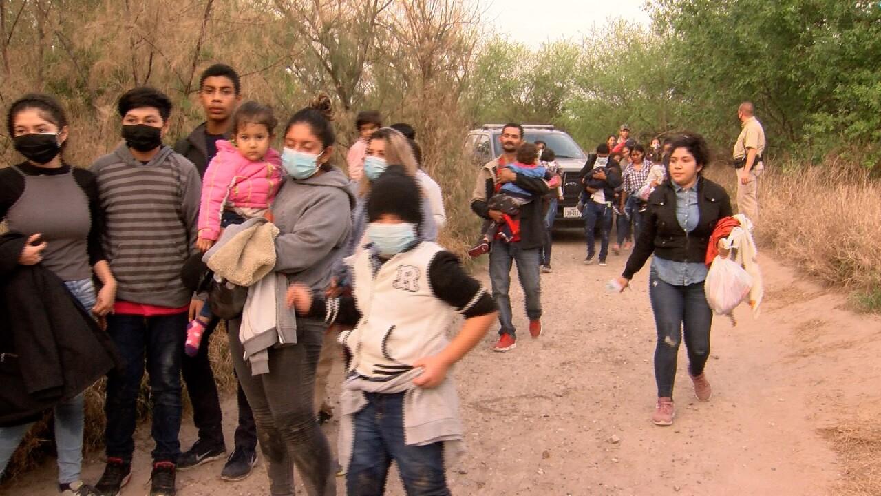 migrants walking day.jpg