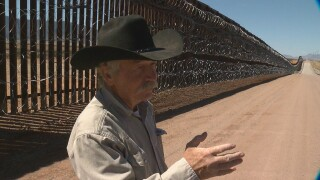 Border-John Ladd-at fence.jpg