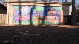 Artist beautifies alleys with garage door murals boosted by augmented reality