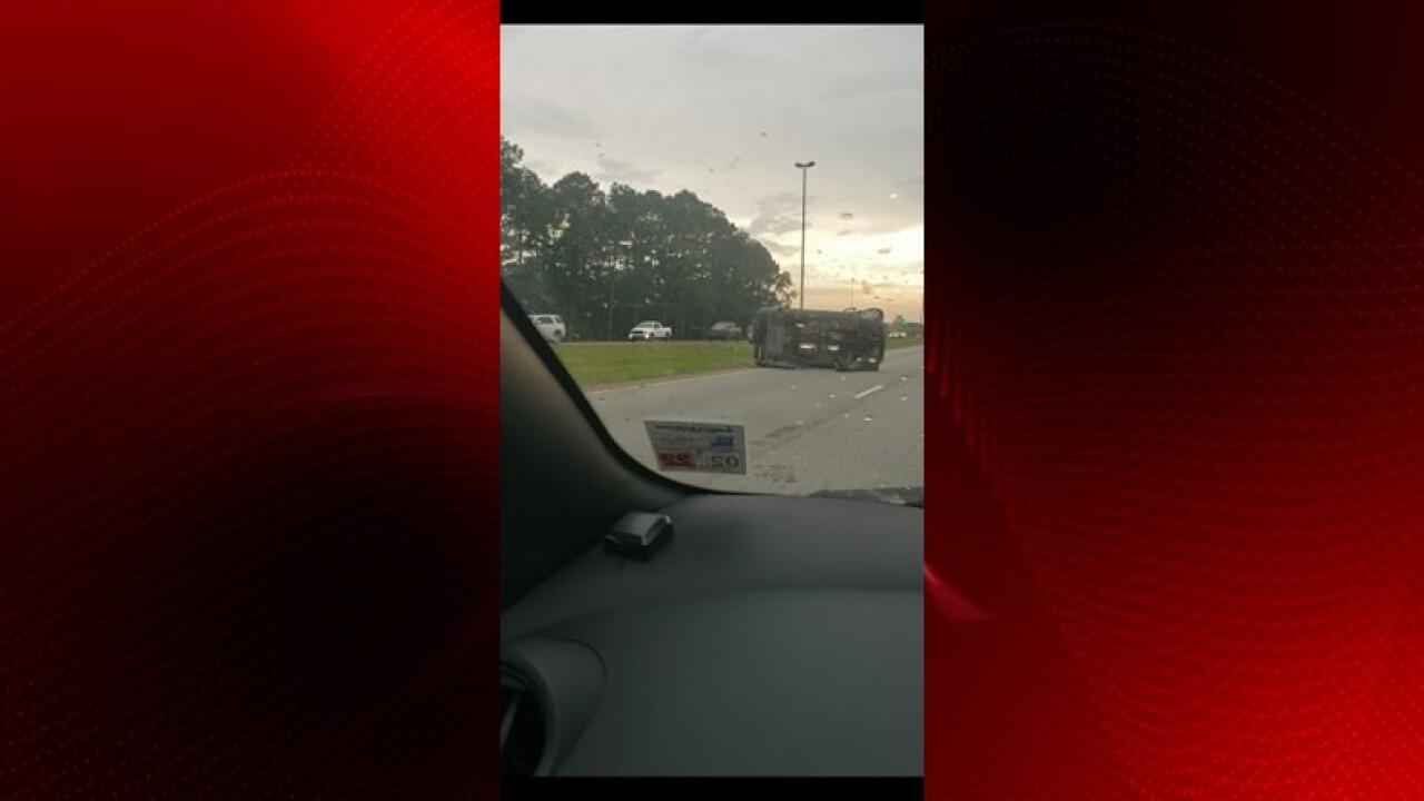 Image of overturned car on I-10 W near Duson. Photo by Brandy Warren.