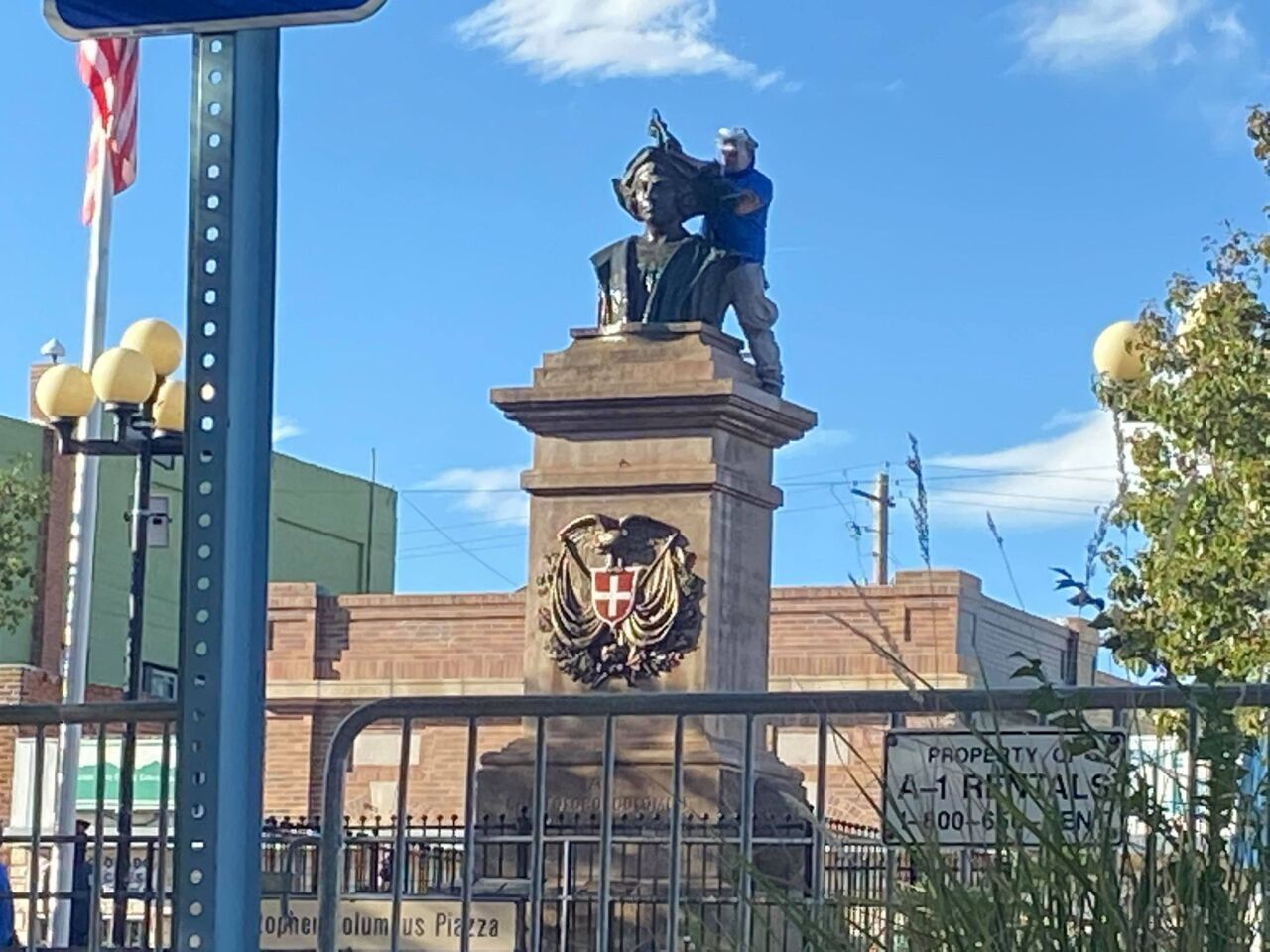 Pressure cleaners were working on removing the last remnants of paint on the Christopher Columbus statue in Pueblo late Sunday morning