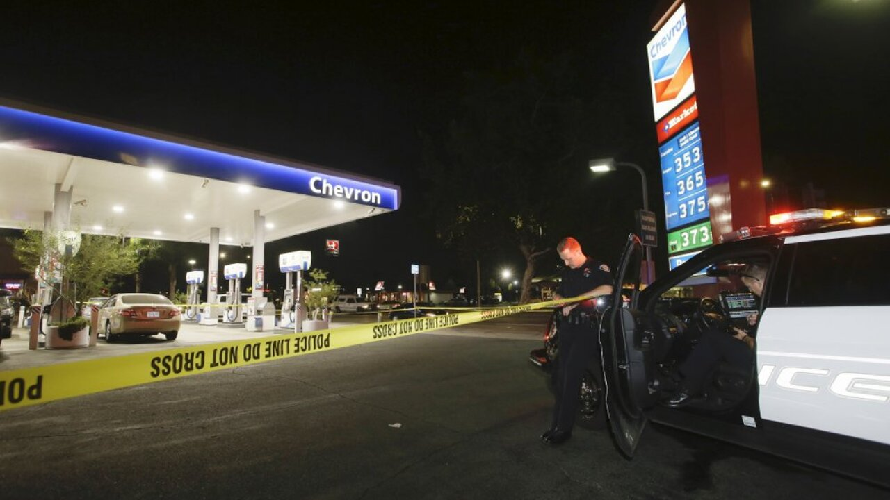 Garden Grove police stand watch at the scene of a stabbing in Garden Grove, Calif., Wednesday, Aug. 7, 2019. A man killed multiple people and wounded others in a string of robberies and stabbings in California's Orange County before he was arrested, police said Wednesday. (AP Photo/Alex Gallardo)