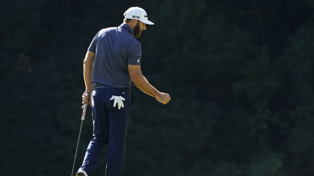 Dustin Johnson pumps fist after birdie on 15th hole on final day of Masters in 2020
