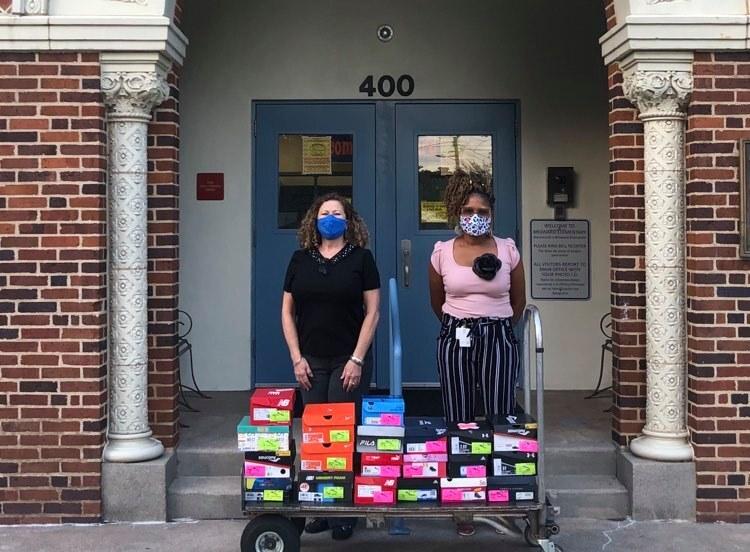 volunteers_donate_shoes_broward_elementary.jpg