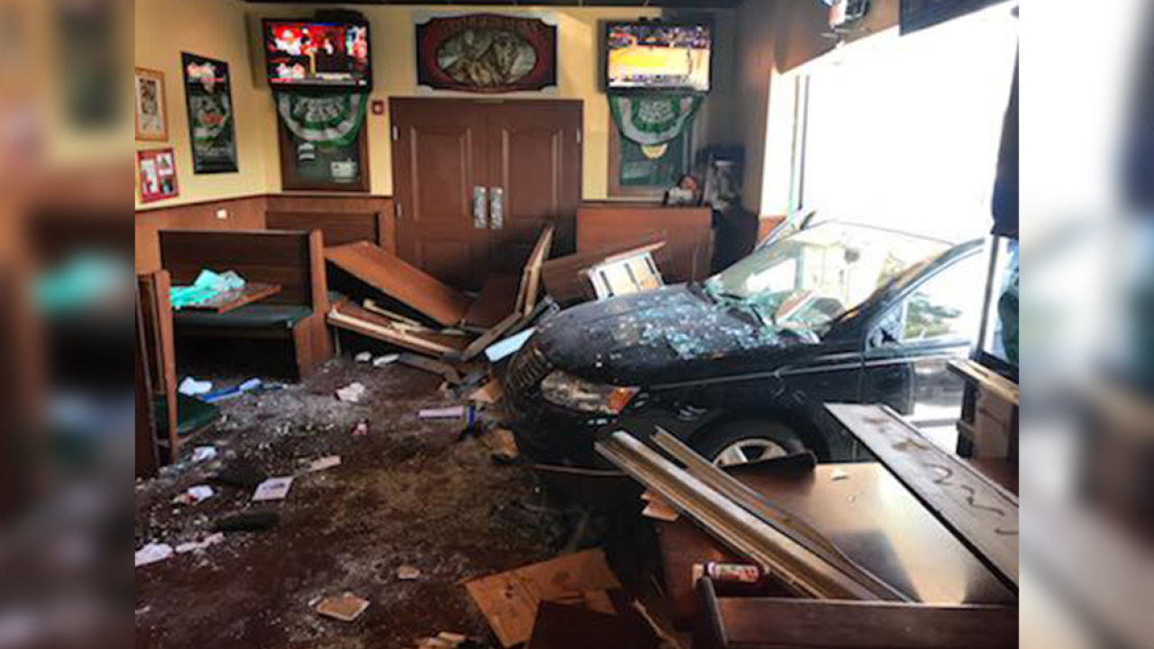 Video shows car jump curb, crash into Beef 'O' Brady's in