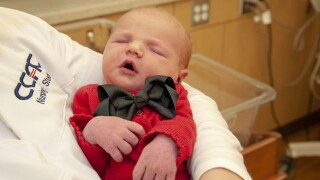 Hospital dresses newborns as Mister Rogers in honor of World Kindness Day