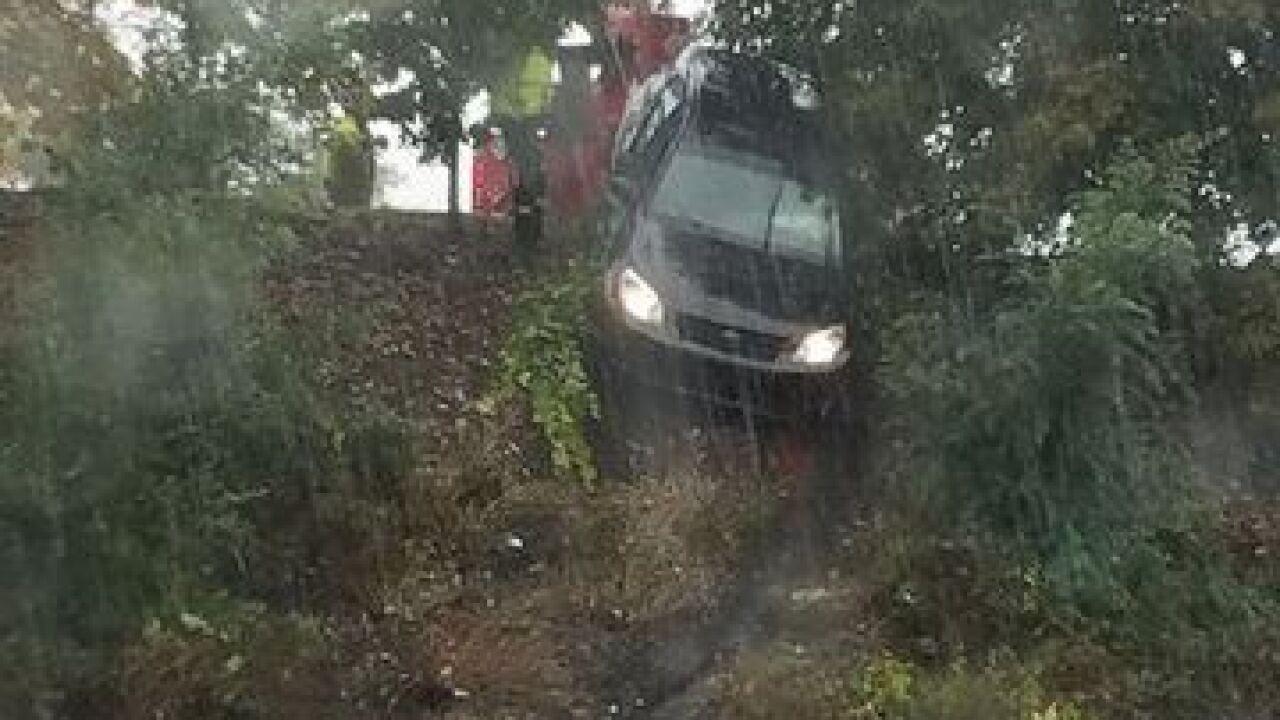 Car rolls down embankment in I-696 in Warren