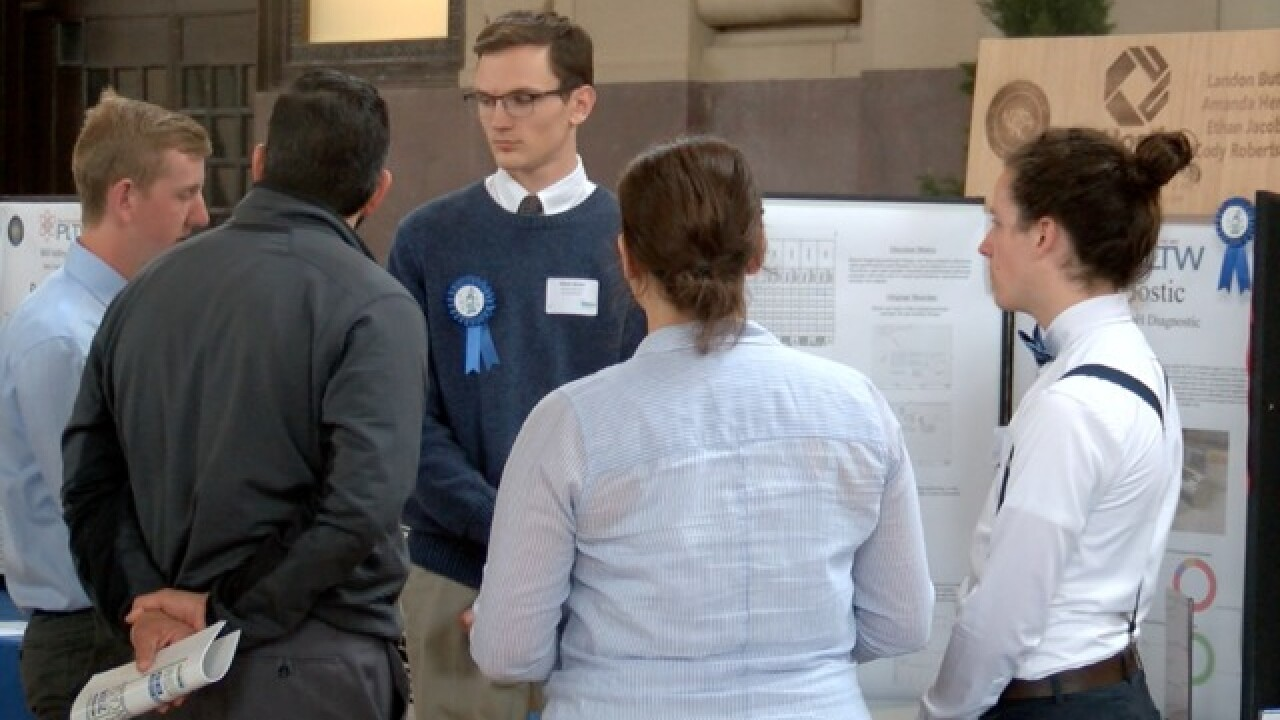 Students show off innovations at senior showcase