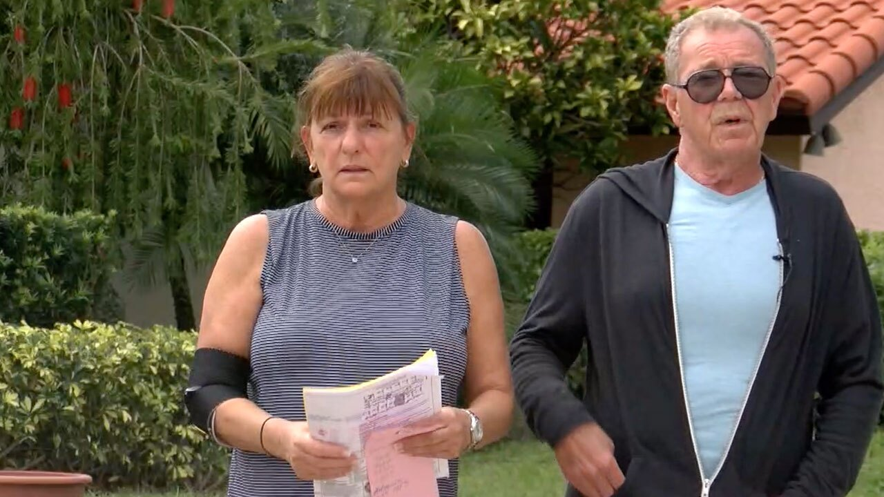 Gary Lustburg and his wife, driveway ripped up on sidewalk