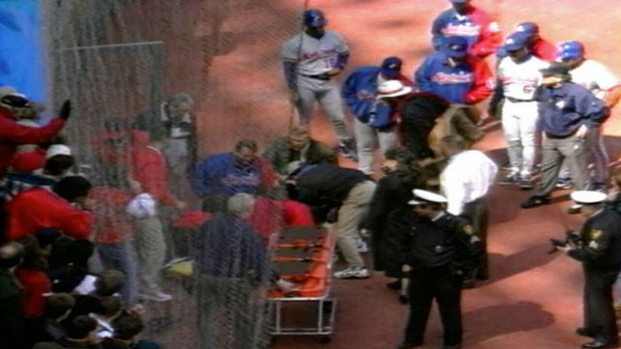 A gurney was brought on to the field at Riverfront Stadium to move umpire John McSherry to an ambulance, April 1, 1996.