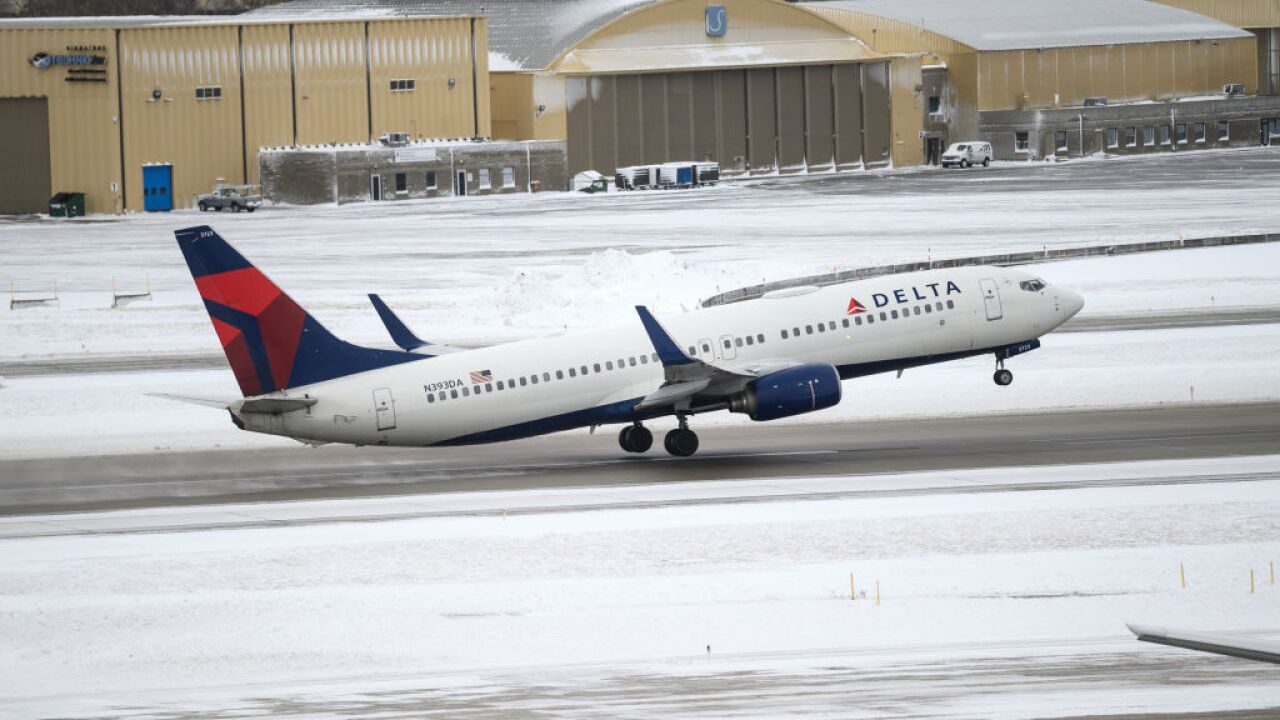 Airlines offer waivers as severe weather leads to thousands of flight delays, hundreds of cancellations