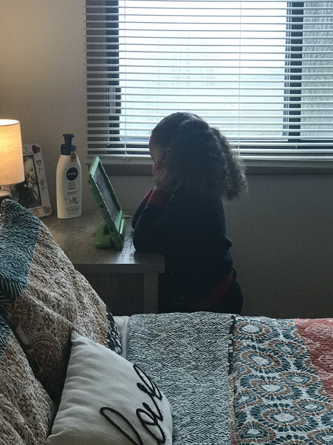 Brielle attends virtual class in her mom's room. The little bit of separation allows for Nicole to be able to concentrate as she is teaching.