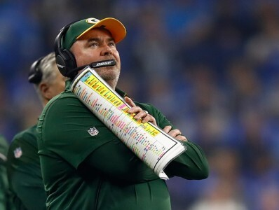 Former Packers coach Mike McCarthy holds plays