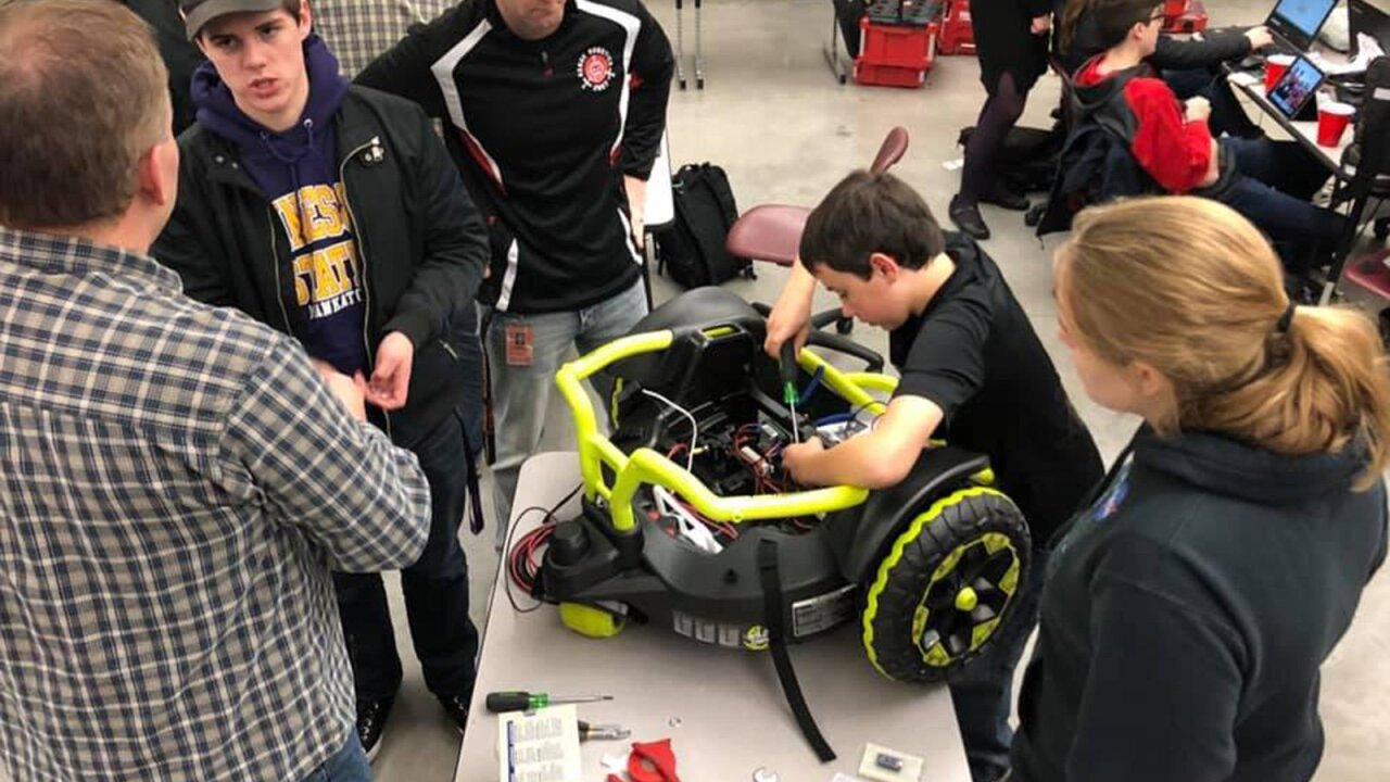 A 2-year-old couldn't walk on his own. So a high school robotics team built him a customized toy car