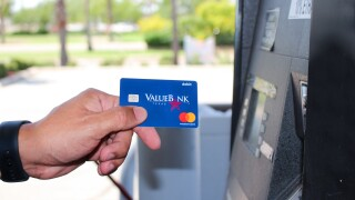 ValueBank Texas Debit Card being used at a gas pump.