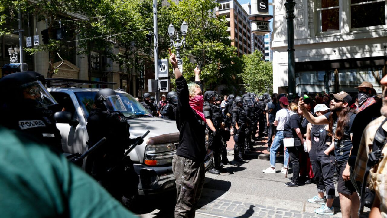 Portland protests turn violent, leaving eight injured, including three police officers