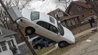 car stuck on pole parchment.jpg