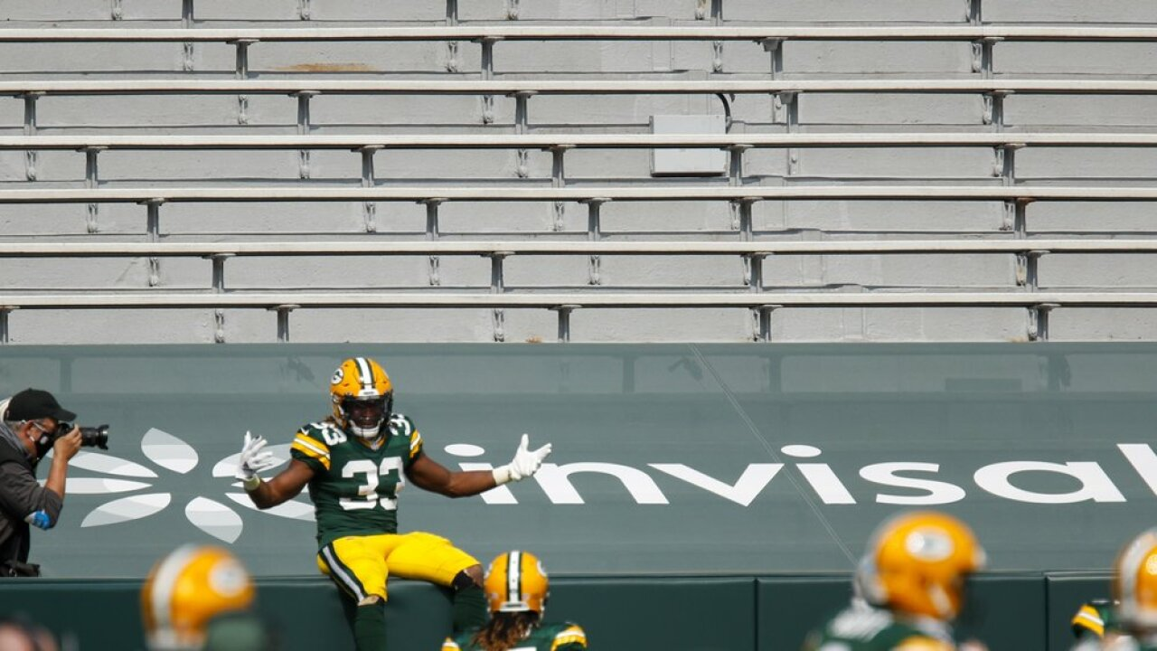 Aaron Jones celebrates touchdown with empty stands Packers vs Lions.jpeg