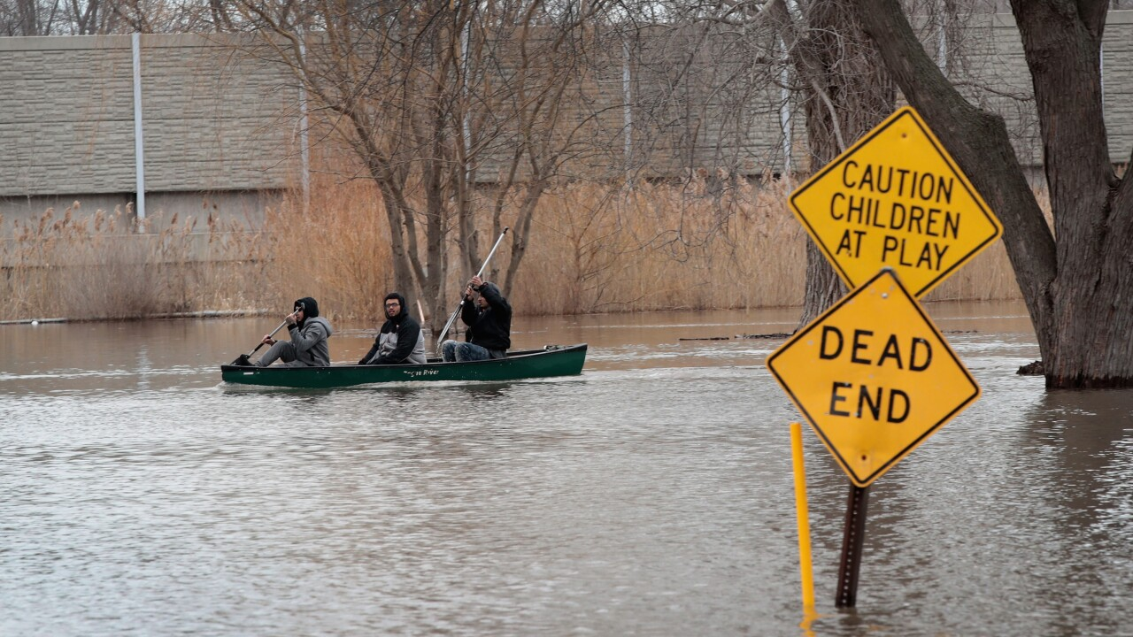 Rains And Snow Melt Lead To Major Flooding And Evacuations In Midwest.jpg