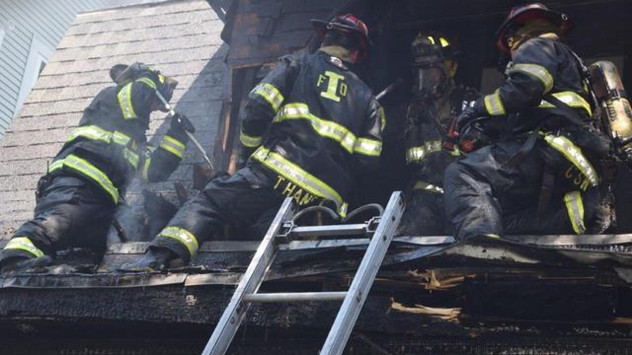 PHOTOS: IFD revives dog in north side house fire