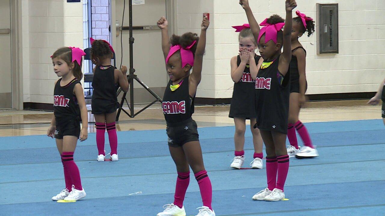 Cheerleaders raise $3,700 for families of injuredveterans