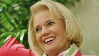 In this Thursday, April 15, 2004, file photo, Designer Lilly Pulitzer, smiles during an interview in her clothing company's Manhattan fashion district offices. Pulitzer, known for her tropical print dresses, died in Florida at 81 on Sunday, April, 7, 2013.