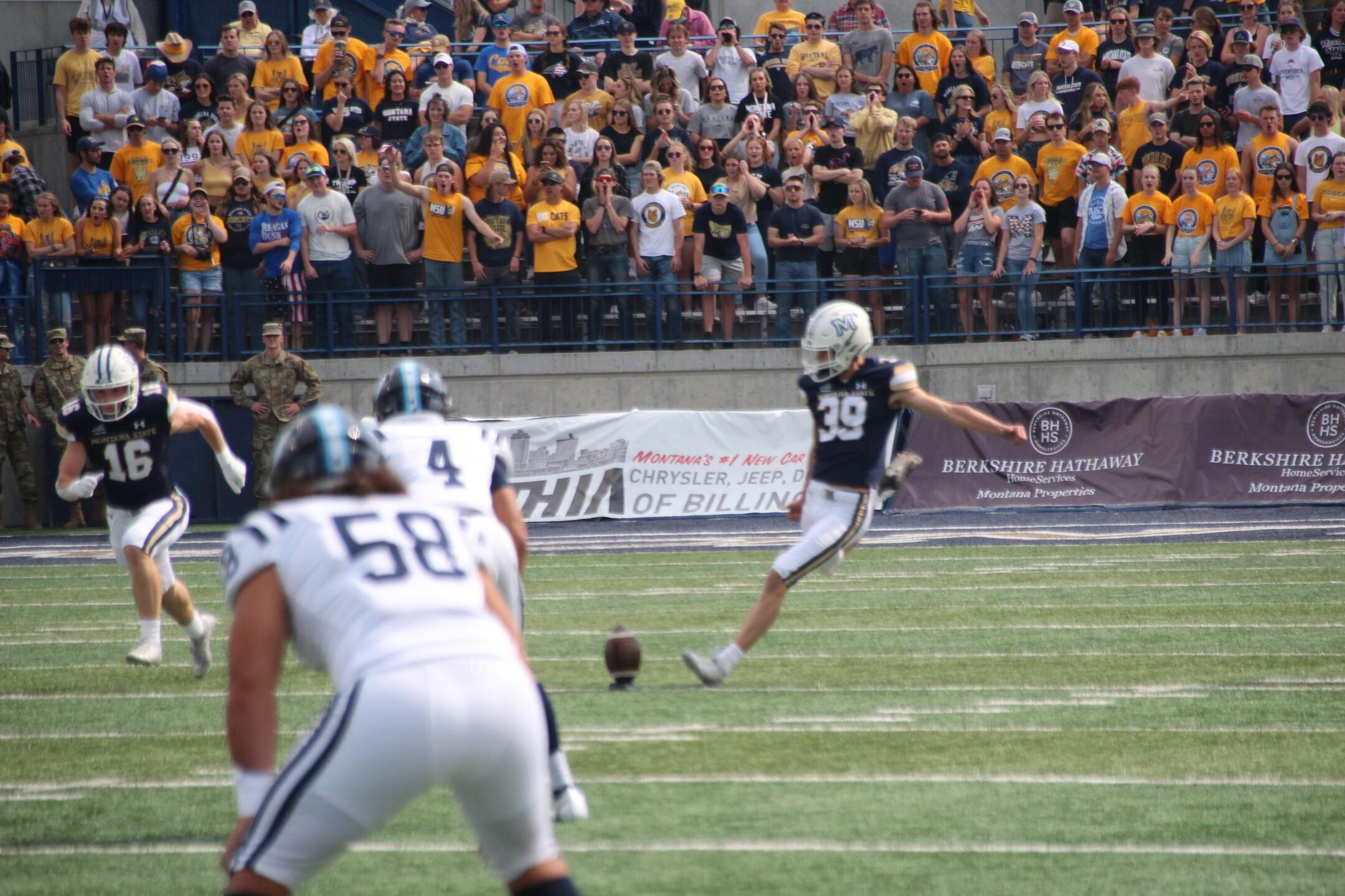 Kicker Blake Glessner kicks off after a touchdown