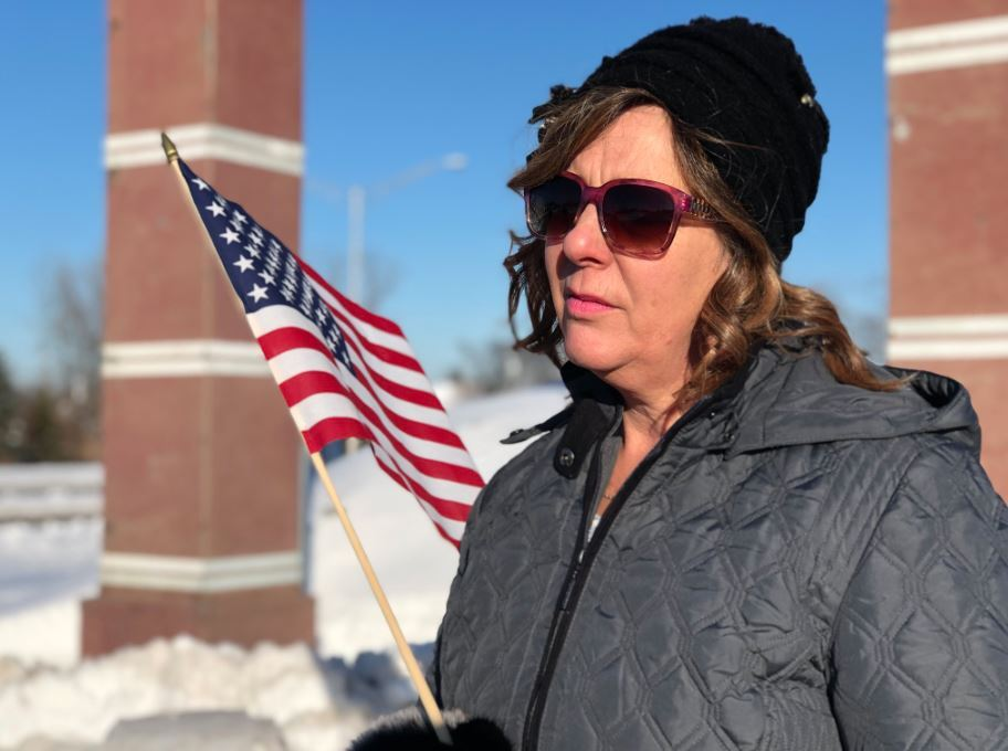 Retired Milwaukee County Sheriff's Deputy Colleen Giese pays her respects to Officer Rittner