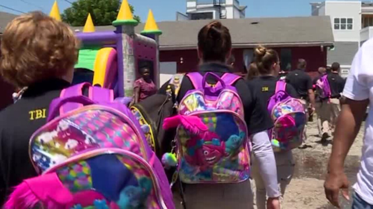 TBI Agent Organizes Backpack Delivery To Students In Need