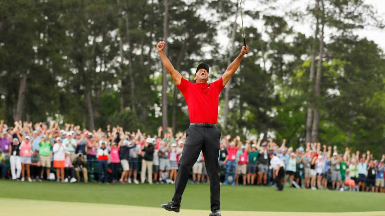 Tiger Woods of the United States celebrates after making his putt on the 18th green to win the Masters at Augusta National Golf Club on April 14, 2019 in Augusta, Georgia.