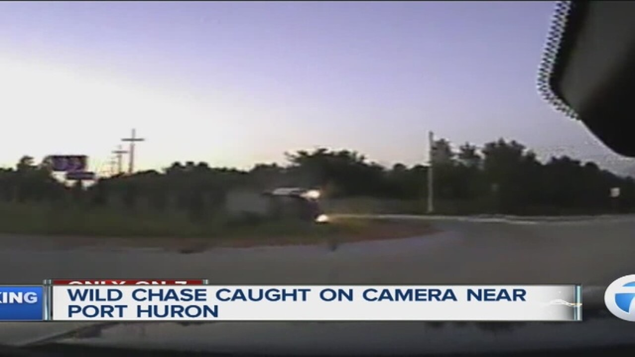Dash-cam video shows wild police chase end with car flipping at 90 mph in roundabout