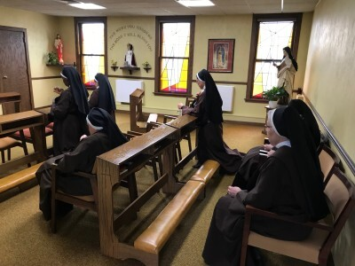 Carmelite nuns pray