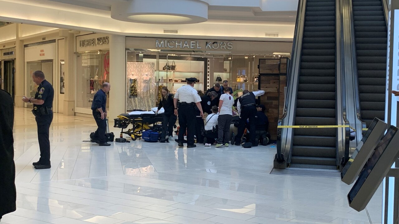 A man is in custody after witnesses say he threw or pushed a child from Mall of America balcony
