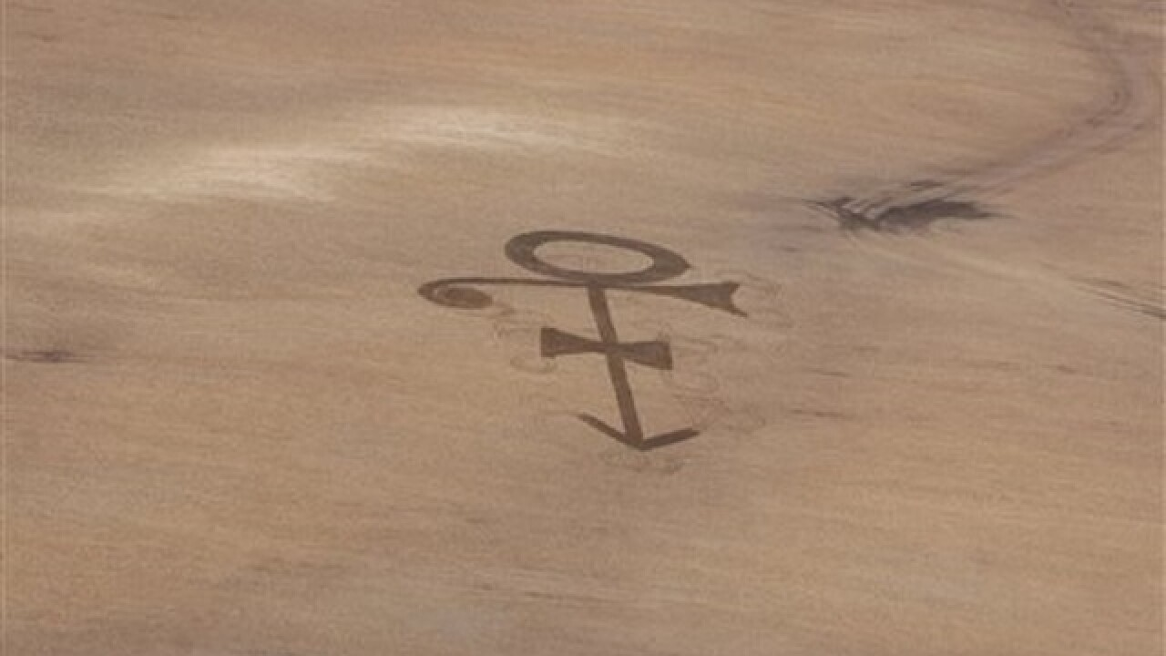 N.D. man plows Prince's symbol in farm field