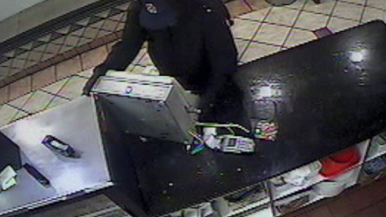 Donut shop robber runs off with cash register