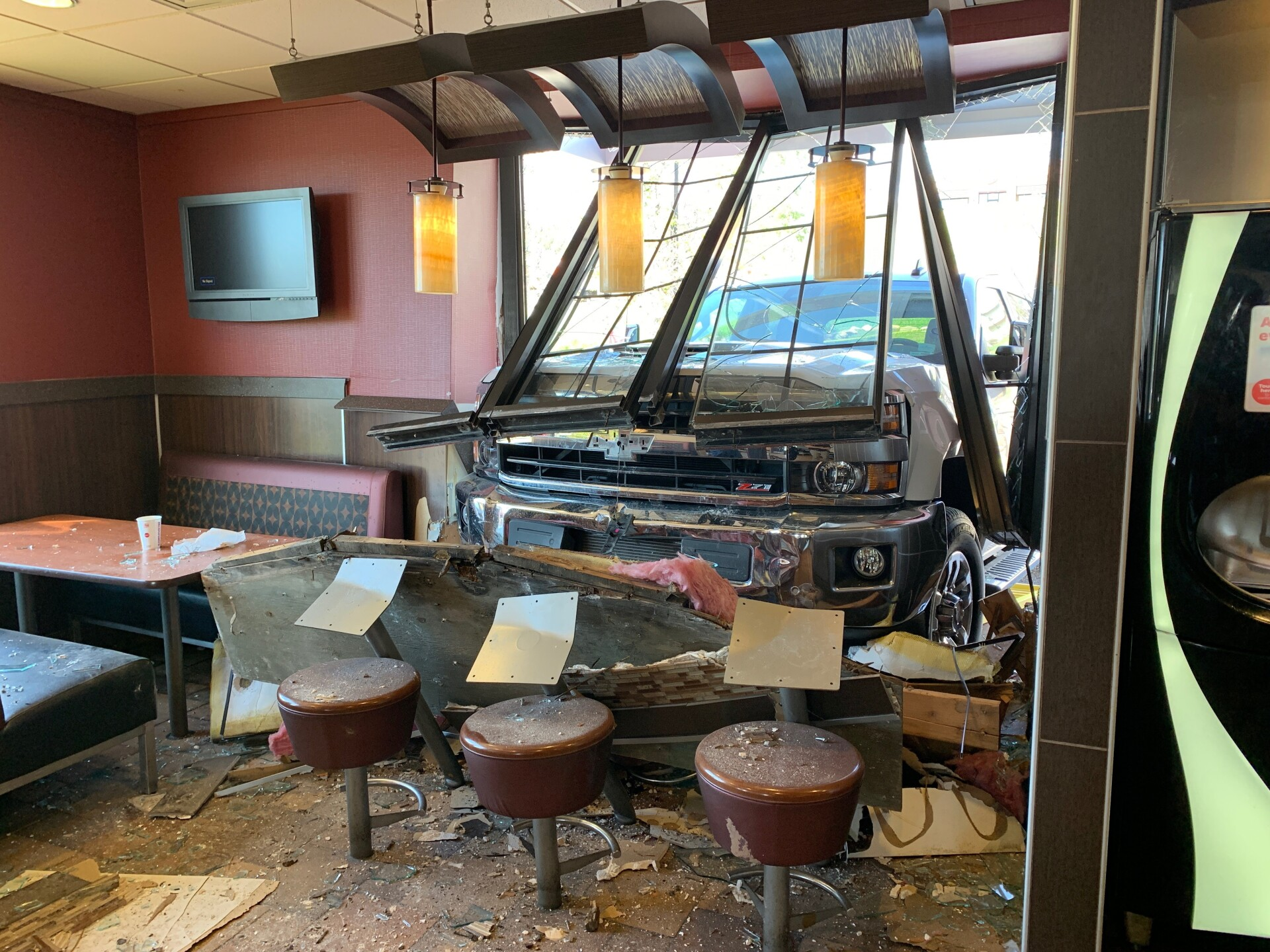 Photos: No injuries after truck smashes through window at McDonald's in Summit County