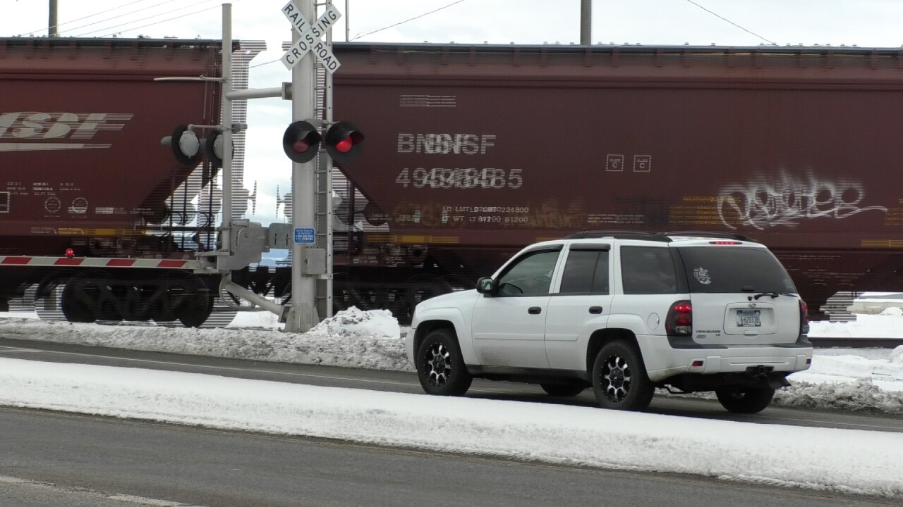 Cars wait for train at Jackrabbit Lane and Main Street intersection in Belgrade.
