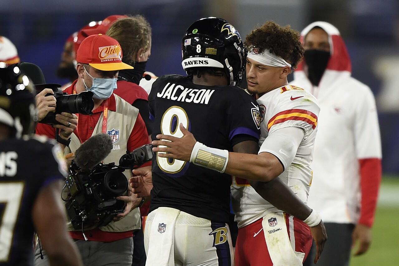 Baltimore Ravens QB Lamar Jackson hugs Kansas City Chiefs QB Patrick Mahomes in 2020