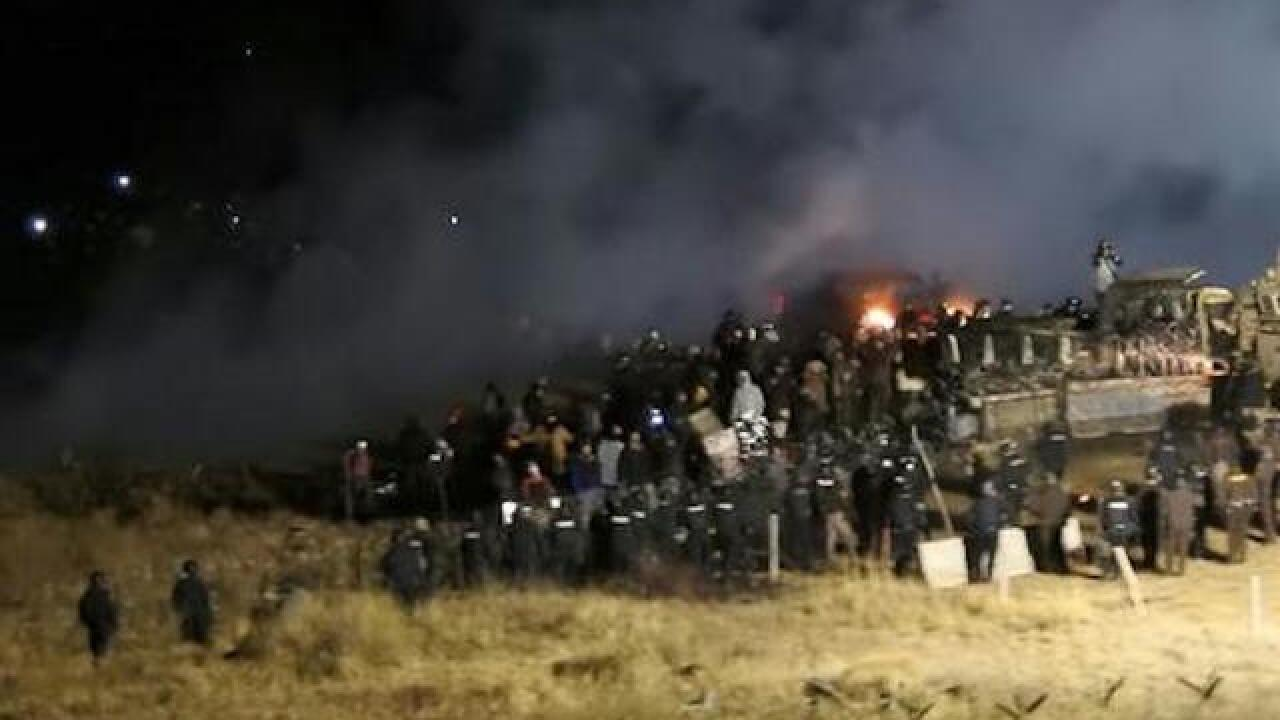Officers spray water at pipeline protests in subfreezing weather