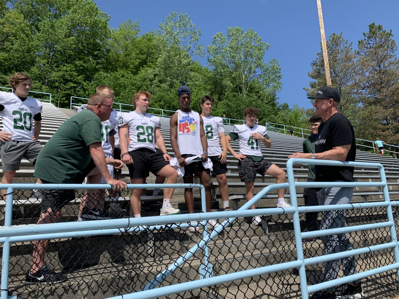 Merril Hoge speaks with the Forest Hills Central football team