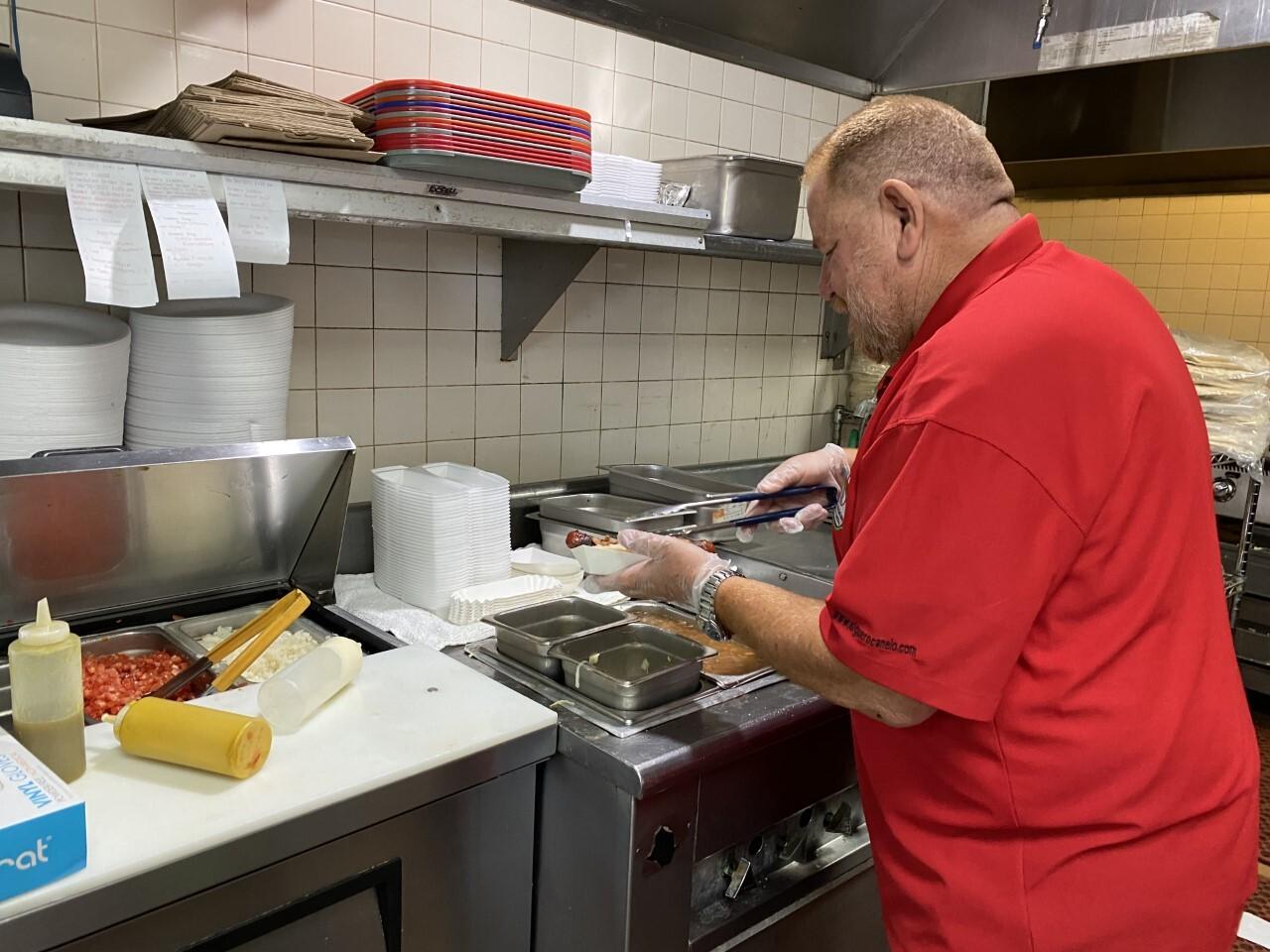 Daniel Contreras making a Sonoran-style hot dog