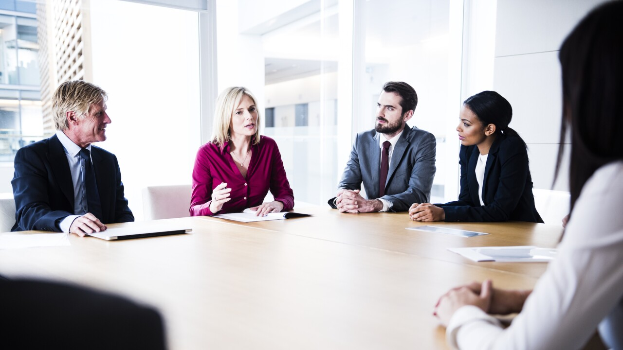 Confident businesswoman making her point in business meeting