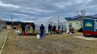 Carroll College students prep Helena Food Share garden