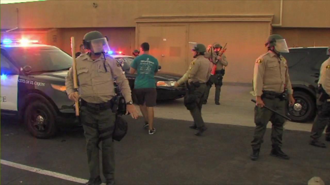 Protesters rush man in Trump gear