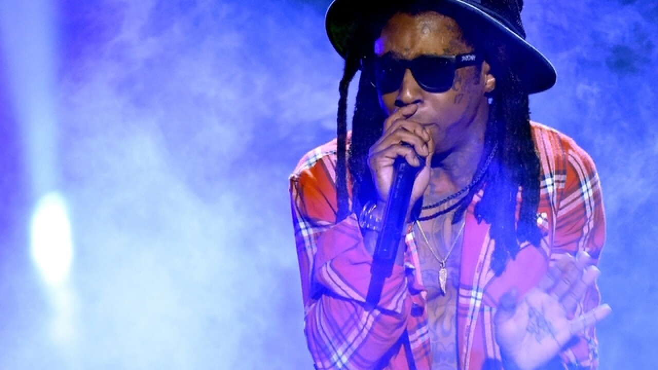 Lil Wayne concert in Atlanta ends early in chaos, at least 12 injured